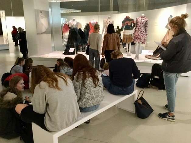 Textile students are engrossed in a history of fashion